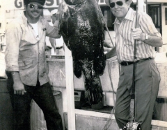Walter Kirchner left with a 120-pound jewfish caught on the Charter boat Gulf Stream. From the Dale McDonald Collection.