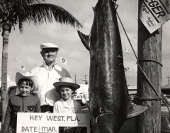 A 173 pound blue marlin on the scales at the docks in Key West caught on the charter boat Cay Sal with Captain Williams by the White family on March 16, 1971. A man and two childern are in the photos. Photo from the Wil-Art Stuido, gift of Angie Marine.