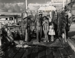 Cat. Tony Terracino, wife and daughter Coral C 1960 with a large catch of jewfish. Photo by Wil-Art Srudio.
