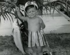A young boy with a small tarpon C 1968. Photo by Wil-Art Studio from the collection of Angie Marine.