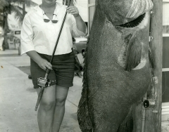 A woman with a large jewfish caught on a Key West charterboat C 1968. Photo by Wil-Art Studio from the collection of Angie Marine.